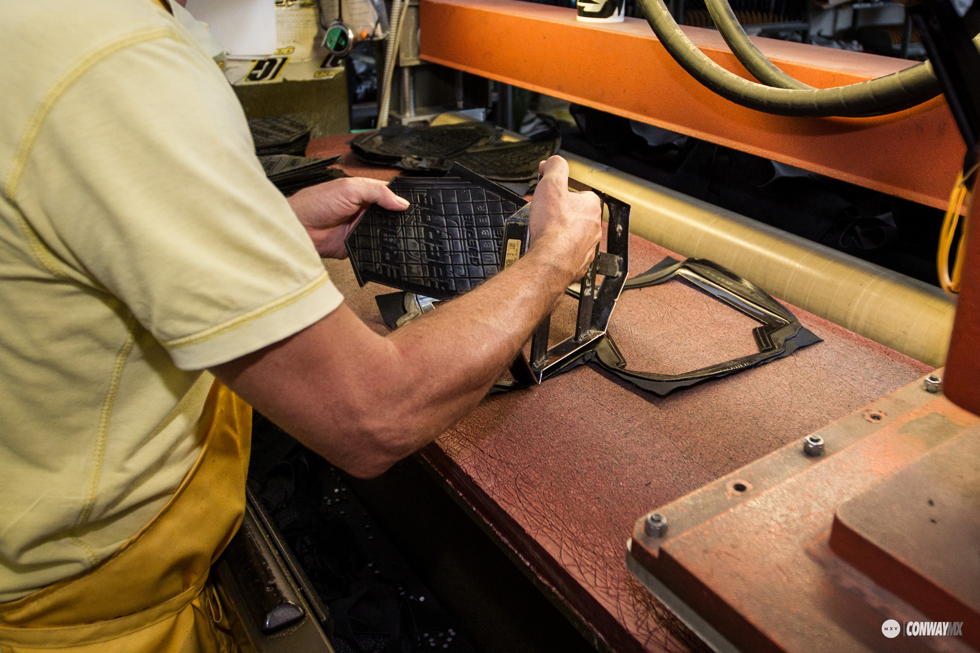 The process begins with the cutting of each panel. The leather is first printed and then stamped, using a traditional die cutting technique used in the shoe industry since the mid-19th century. Here you see the branded inside leg panel of the SG-12 boot.